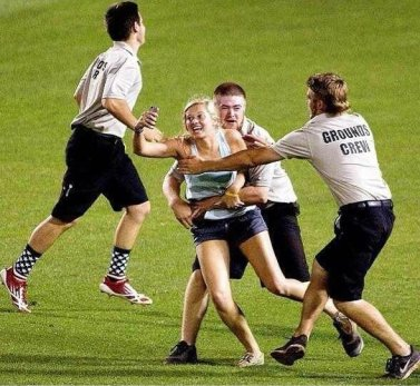 kayleigh-hill-ran-out-onto-a-baseball-field-during-the-2013-college-world-series-game-and-filmed-herself-being-tackled-by-security-guards-on-vine-all-for-the-sake-of-a-really-good-selfie